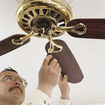 attaching the blades and lights to a ceiling fan