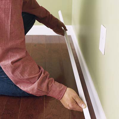 Attach molding to baseboards