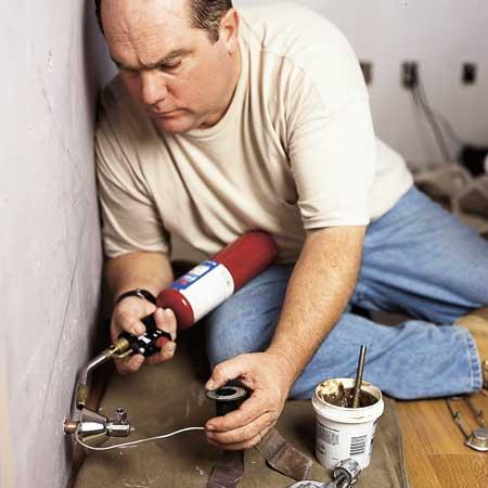 Richard Trethewey installing a toilet
