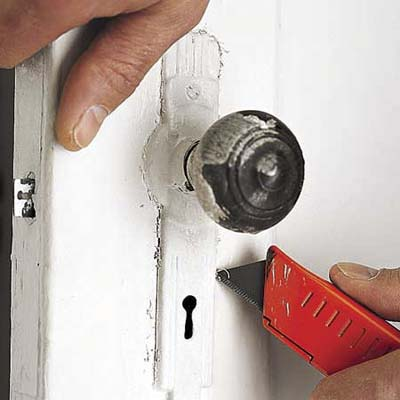 cut paint on door hardware with utility knife