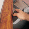 Dusting woodwork post sanding before painting a room