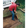 Digging trenches for bed walls, using a spade.
