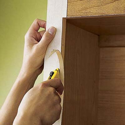Trimming the veneer.