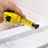 Centering the base track of a shower door