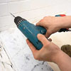drilling holes for a shower door with a 3/16-inch-diameter masonry drill bit
