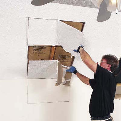 Mark the skylight opening and cut out rough opening with a drywall saw