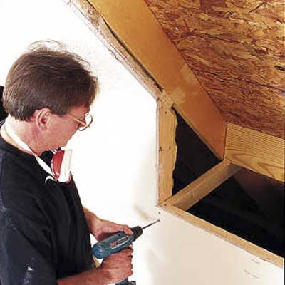 Drive nails through the plywood roof sheathing in each of the four corners of the rough opening