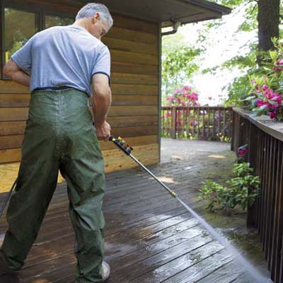 wash the deck and railings with a garden hose or pressure washer