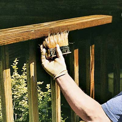 apply the stain full-strength with a synthetic filament brush to the deck railings