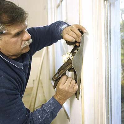 Tom Silva trimming out a window