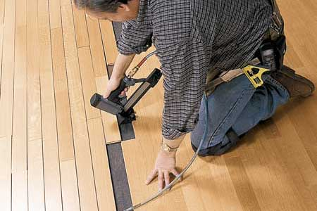laying engineered wood floors tout