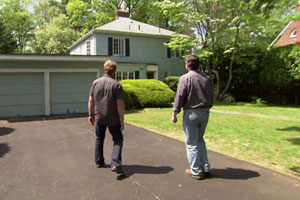 Norm Abram and Kevin O'Connor approach the Auburndale house before the beginning of renovation