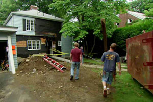 Kevin O'Connor approaches the Auburndale house at the beginning of renovation