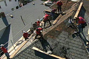 working on the roof of the East Boston house project
