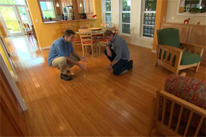 kevin and the essex homeowner examining the new floor as part of this old house tv episode 25 design for everyone