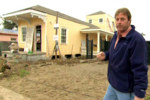 Roger Cook in front of the New Orleans house project