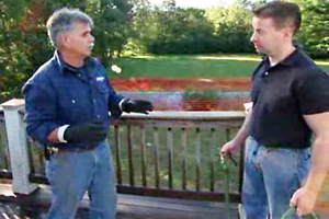 Tom Silva demonstrates how to clean and restain a deck