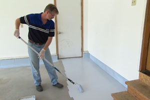 Doug Fasching coats a garage floor with epoxy