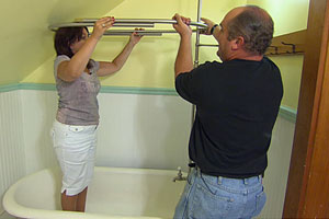 Richard Trethewey and homeowner dry-fitting the shower assembly