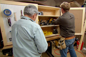 Tom Silva and Kevin O'Connor build a tool storage cabinet