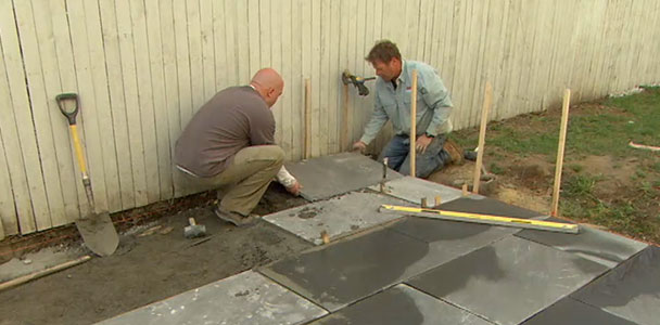 Roger Cook installs a bluestone patio