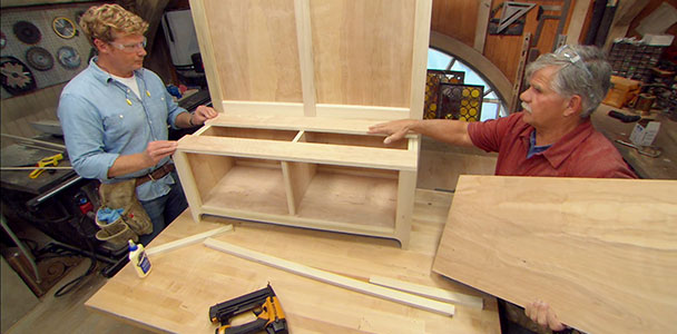 Tom Silva and host Kevin O'Connor build a storage bench