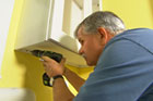 Tom Silva helps a homeowner purchase and install a kitchen wall cabinet