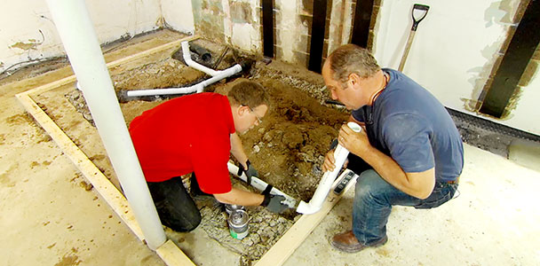 Richard Trethewey shows how to rough-in the drainpipes for a basement bathroom