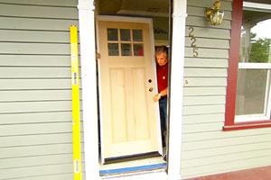 Tom Silva helps a homeowner install a new, energy-efficient wood door