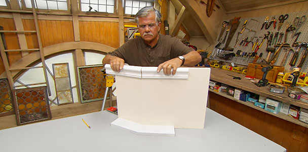 Tom Silva checks his miter accuracy with 2 pieces of molding