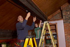 Scott Caron installs track lighting