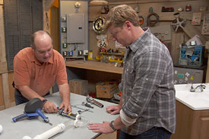 Richard Trethewey shows Kevin O'Connor how to unclog a backed-up bathroom sink