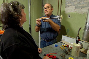 Richard Trethewey helps a homeowner install a new sill cock