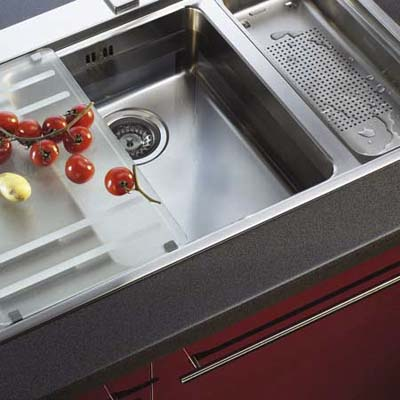 Mythos sink system from Franke with a flexible, tempered satin glass preparation board, a colander, and drain tray