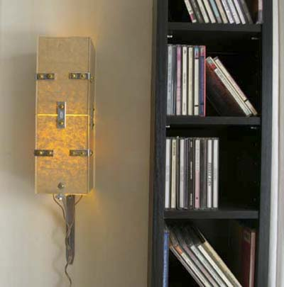 Plexiglas sconce in studio apartment