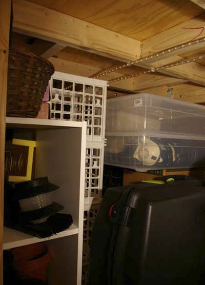 storage area under loft bed in studio apartment